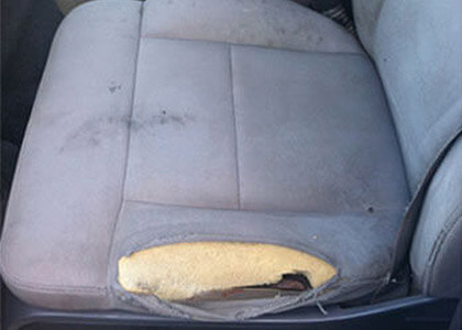 Auto Artisans Inc - Before and After - Torn Cloth with Cushion Damage - Before 1