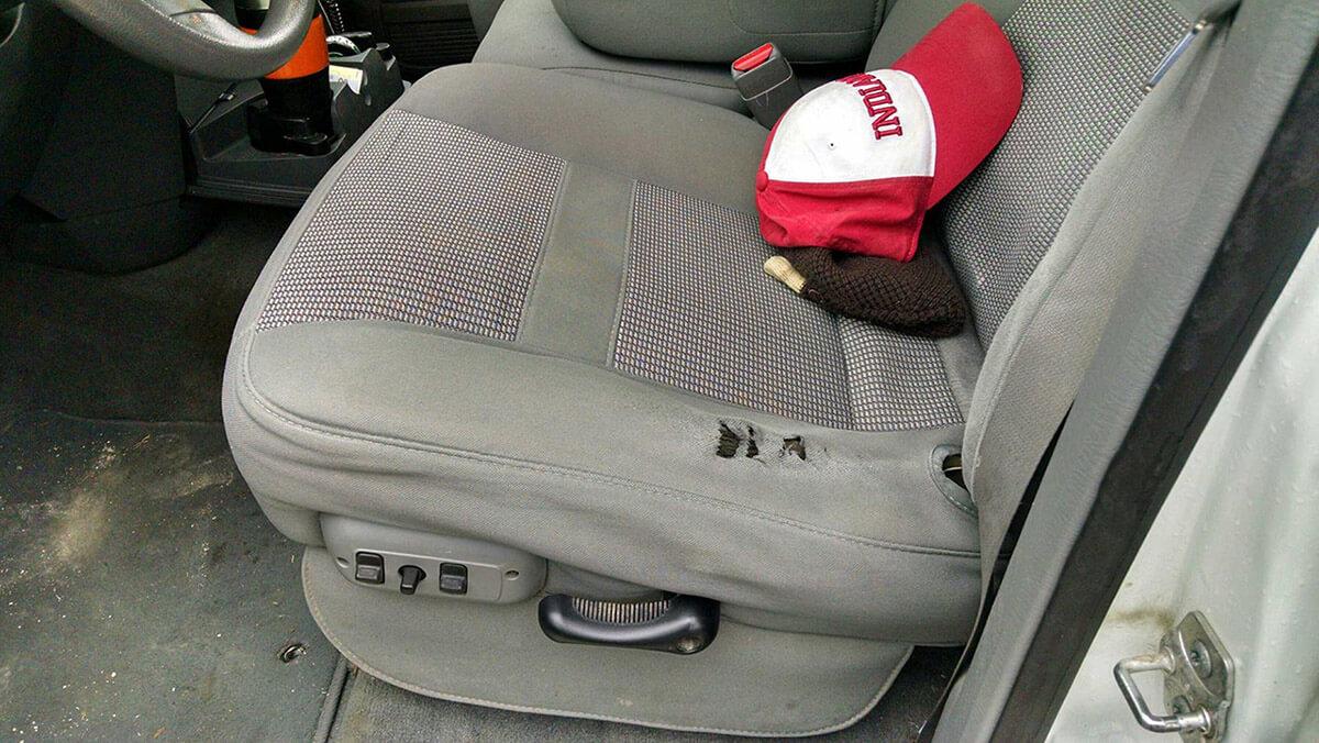 Auto Artisans Inc. - Car Upholstery Repair Before